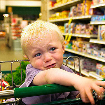 Toddler crying in shopping cart