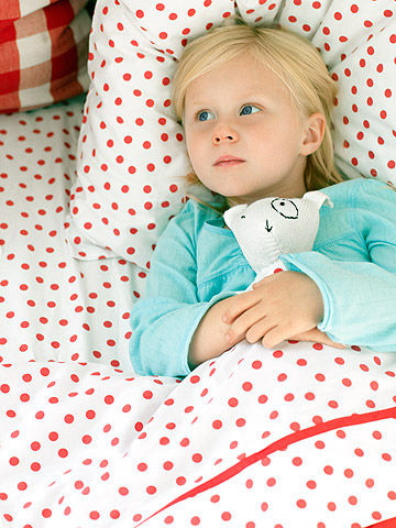 little girl in bed sick