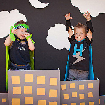 Mini superheroes pose in a photo booth