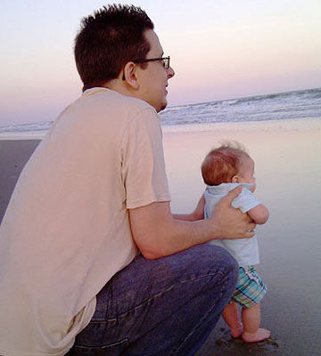 Dad and baby on beach