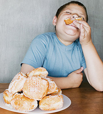 Fat kid eating a doughnut