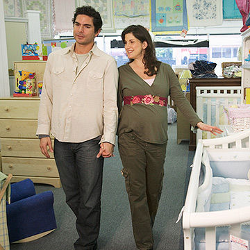 pregnant couple shopping for baby gear