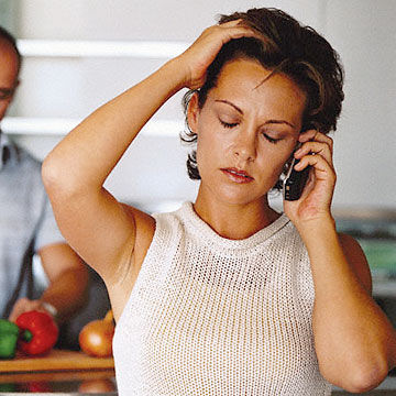 woman on phone looking stressed