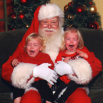 These two kids are sure upset about seeing Santa!
