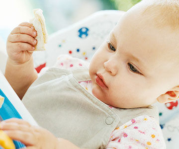 Your guide to babys weight gain baby eating in high chair ccuart Image collections