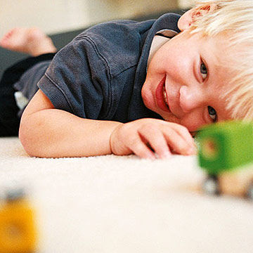 child playing with toy cars