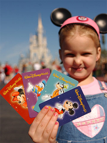 Girl Holding Park Passes