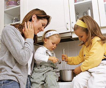 mother cooking with daughters