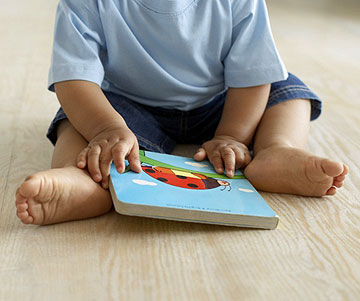 baby holding book