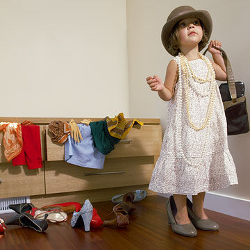 girl playing dress up
