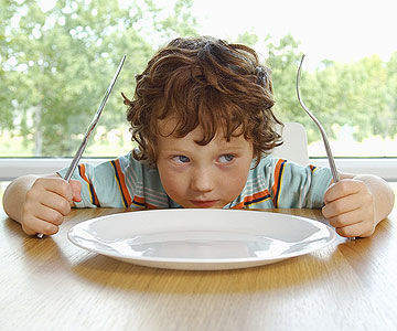 boy in front of plate