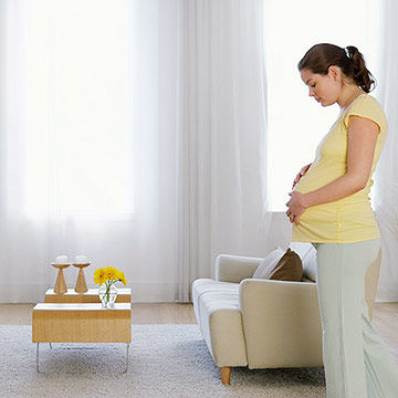 Pregnant woman in living room