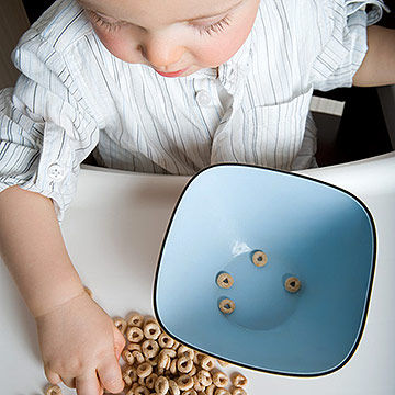 baby eating cheerios