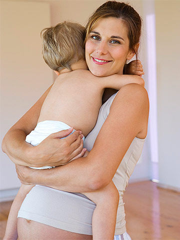pregnant woman hugging son