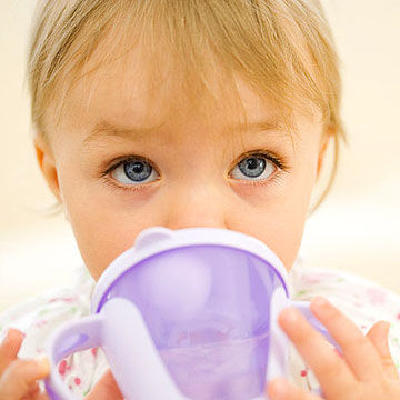 toddler drinking out of sippy cup