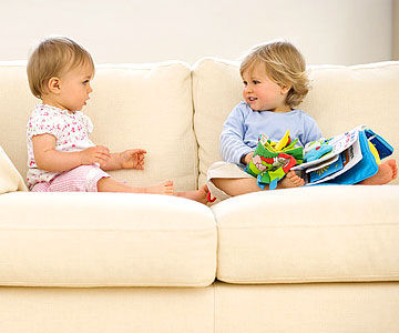toddler's on couch playing