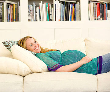 pregnant woman relaxing on couch