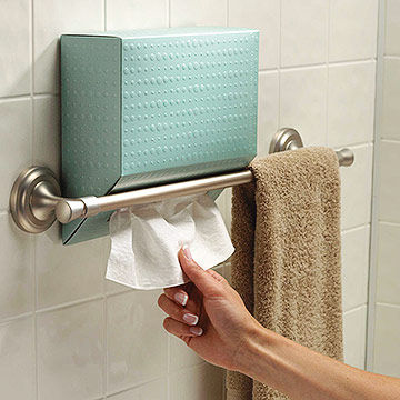 woman using Kleenex Hand Towels