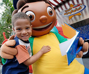 "Boy receiving autograph from Quincy, a ""Little Einsteins"" character"