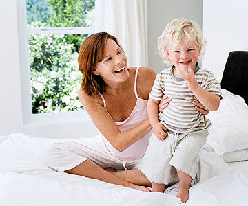 smiling mother with toddler