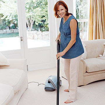 pregnant woman cleaning