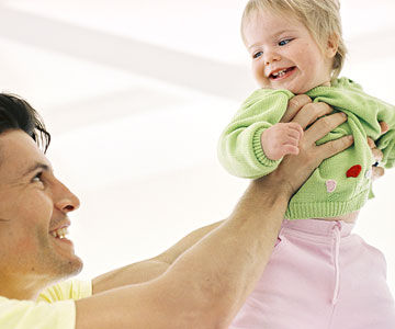 Dad holding daughter in air