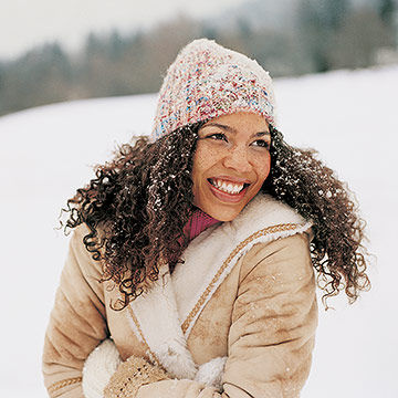 Woman cold in the snow