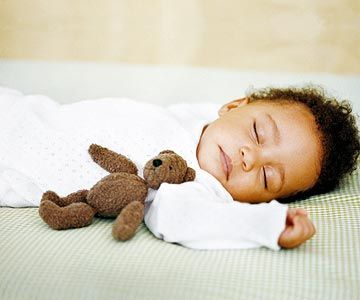 Baby sleeping with bear