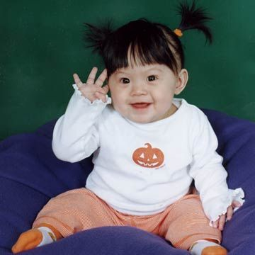 Little Girl With Pigtails Waving