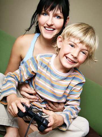 mom and child playing video game