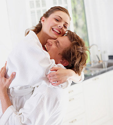 couple in bathrobes hugging