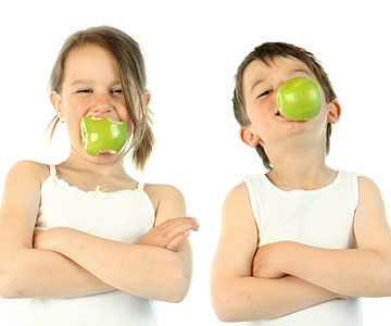 boy and girl eating apple