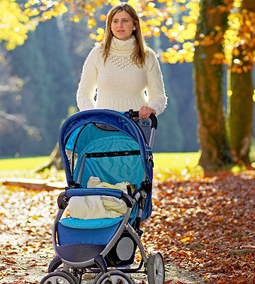 Woman walking with stroller