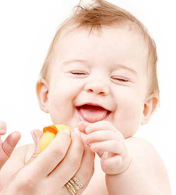 baby laughing at squeaky toy
