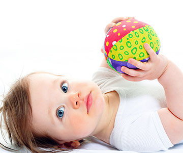 baby holding ball