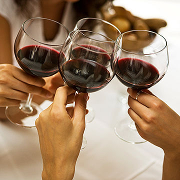 women drinking red wine