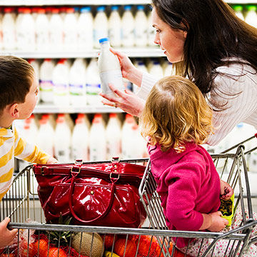 mom and children grocery shopping