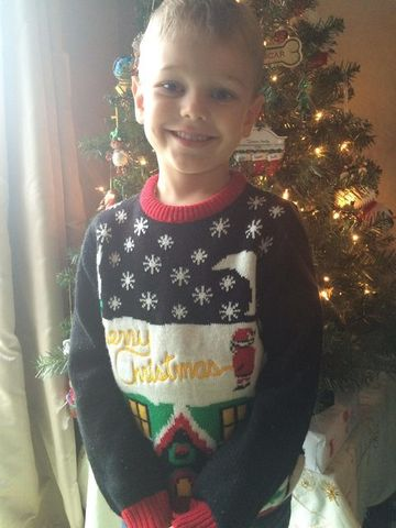 boy wearing inappropriate christmas sweater