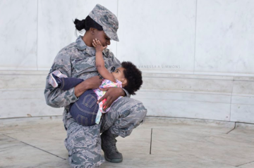 Military mom breastfeeding her baby.