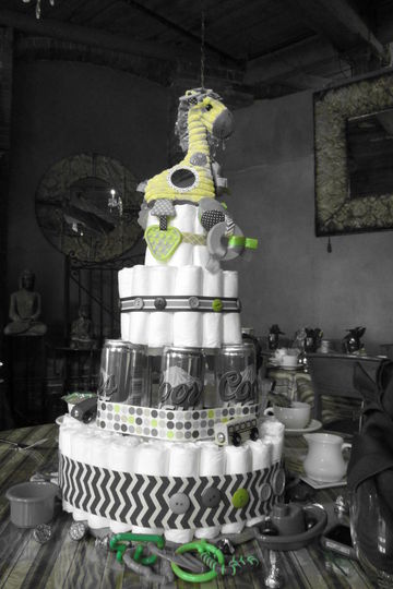Beer can and diaper cake is a twist on traditional baby shower decor at a dadchelor party for men.