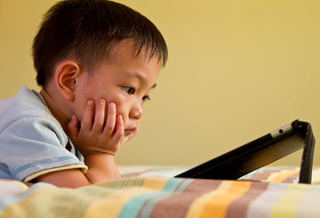boy watching tablet