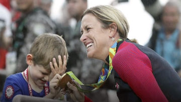 kristin armstrong and son with gold medal