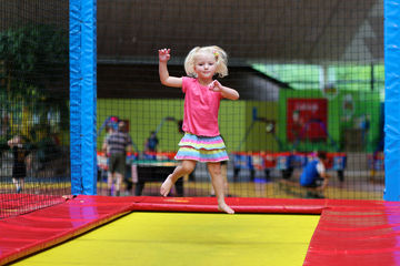 little girl in trampoline park