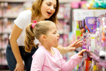 mom and daughter shopping in toy store