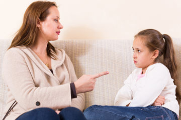mom scolding angry young girl