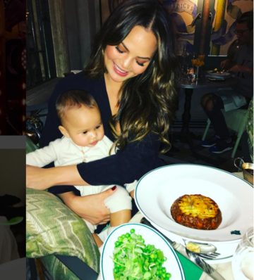 chrissy teigen and luna at restaurant