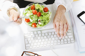 eating salad while working