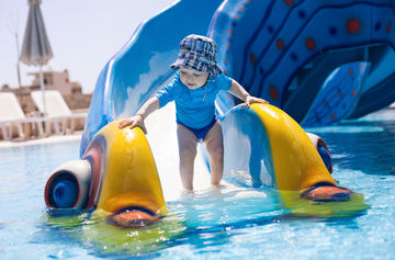 toddler on slide at waterpark