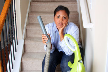tired mom with vacuum