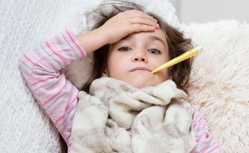 sick girl with fever